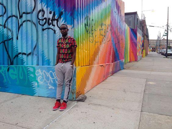 Eddy Kenzo with the colorful street art of Brookyln, New York