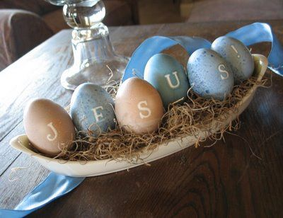CUTE. Dyeing eggs w/natural dyes. LOVE the Jesus display, too!
