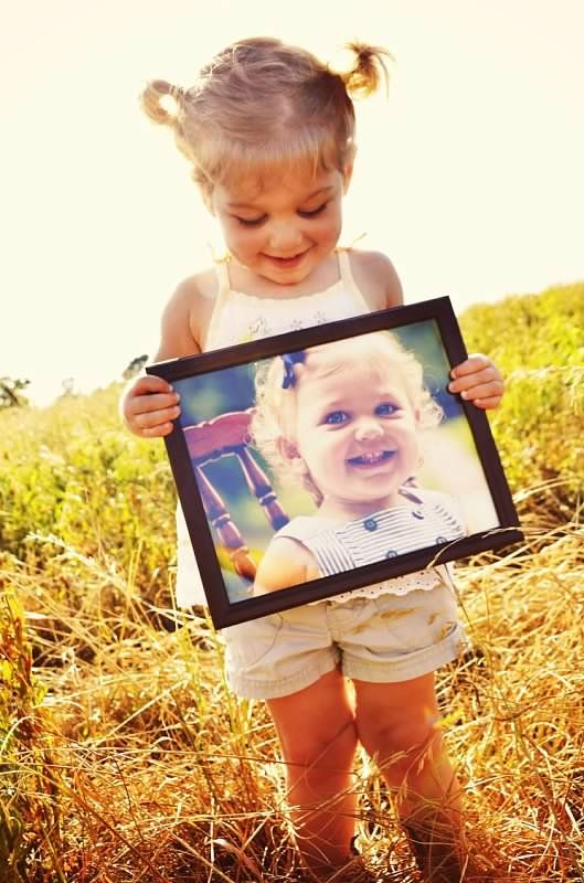 Spring Photo Shoot  Prop Idea: Bring a framed photo of your child's session from last year for them to hold!  Copyright Amber S. Wallace Photography