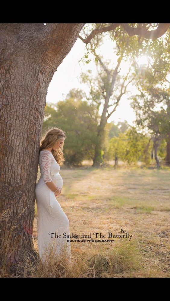 I love this pose by the tree, not her dress or that it's a hint provocative looking b/c her dress is so form fitting. She looks great, but not my style for maternity.
