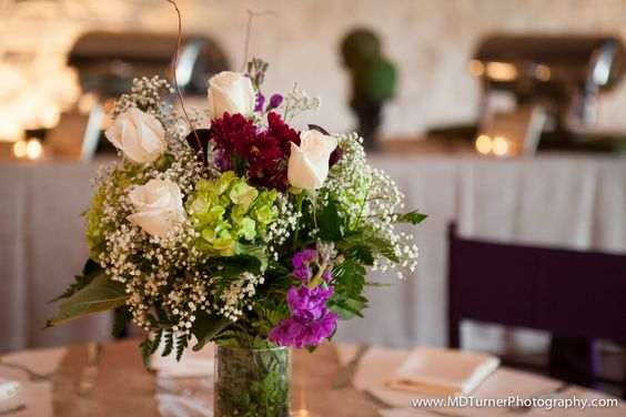 White, purple and green centerpieces with baby's breath - Houston wedding photography - MD Turner Photography