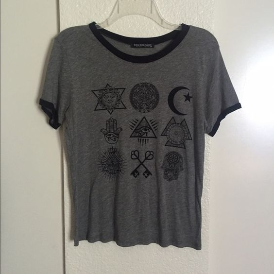 Indie Grunge Top Cute and casual indie/boho grunge tee. Has some cute little logos and symbols on it. I never wore this so its brand new without tags! Tops Tees - Short Sleeve