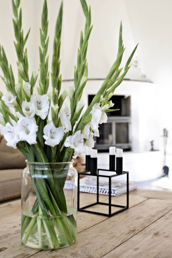 A bunch of white gladiolas in a simple vase can bring instant life to any room.