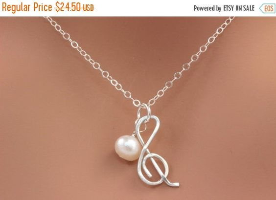 ON SALE Sterling Silver Charm Necklace.Silver Music Note Necklace. Sterling Silver Music lover Necklace with Freshwater Pearl. by rainbowearring on Etsy https://www.etsy.com/listing/122963300/on-sale-sterling-silver-charm