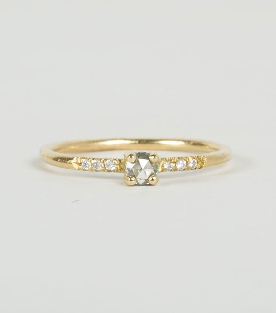 Little Pronged Solitaire Ring with Pavé Diamonds.