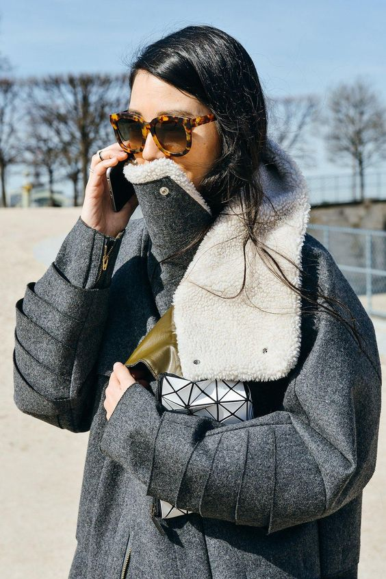 Shearling grey coat with tortoise-shell sunglasses: