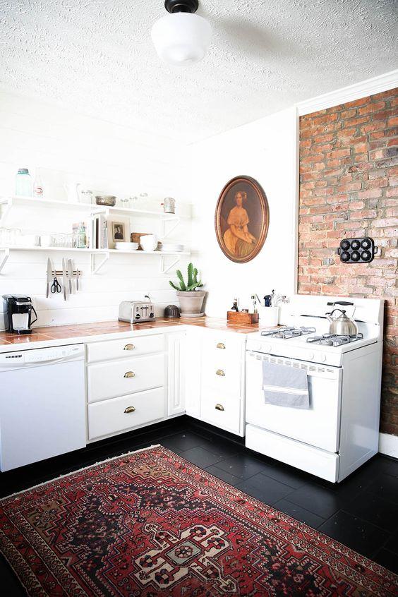 minimal rustic antique home decor, kitchen decor idea, McCarn airbnb in Nashville, kitchen rug, black floors