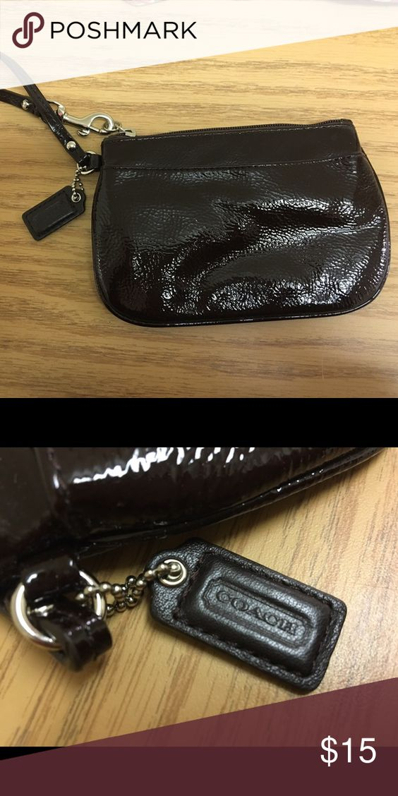 Dark brown coach wristlet Barely used. Dark brown patent leather wristlet Coach Bags Clutches & Wristlets