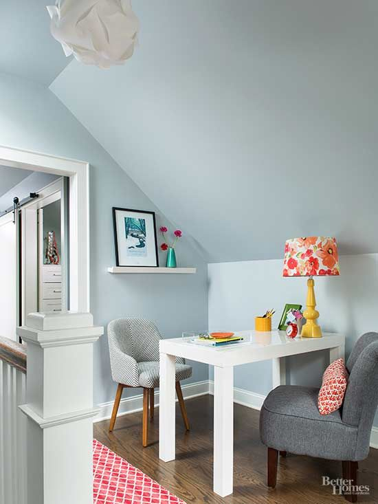The simple work area, made up of a Parsons table and smallscale upholstered chairs, make the most of a landing and function as a mini office nestled conveniently in the corner. Read More About Office Organization/