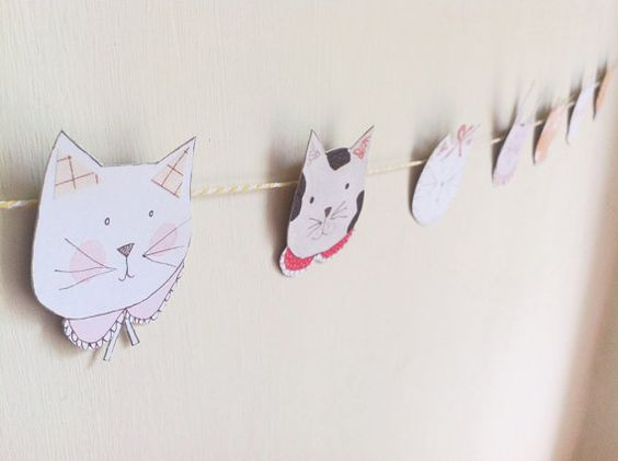 Cat Face Paper Garland by MaisyandAlice on Etsy.