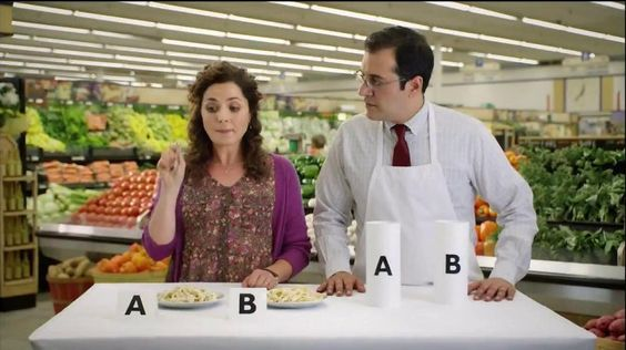 A woman chooses Prego Homestyle Alfredo over Cheesy Ragu Classic Alreado in a taste test.