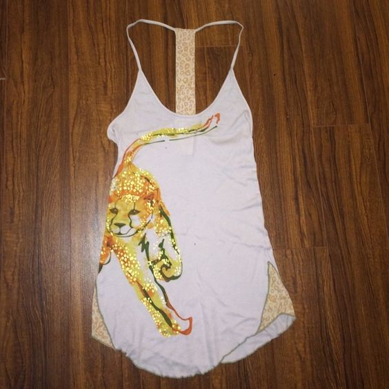 Free people cheetah racerback tank Free people tank top with an awesome cheetah graphic in front and a super skinny racerback with cheetah print on back strap and on sides of tank. Rounded hem size large! (Runs small) only worn once! Free People Tops Tank Tops