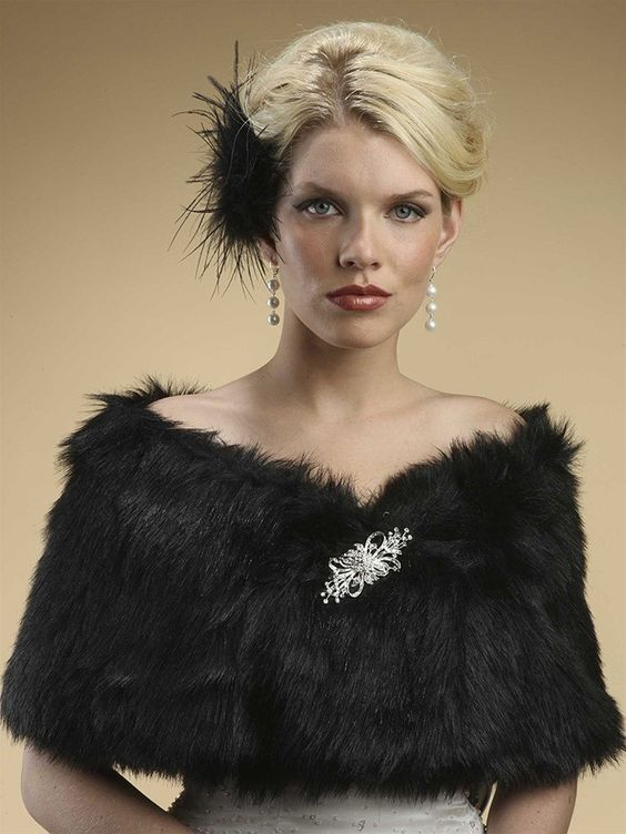 Wear this luxurious vintage inspired Faux Fur Shawl in Jet Black Fox to any holiday party, wedding, prom or special occasion to add warmth and glamour in this 1920s era inspired shawl. This Gatsby inspired shawl is available in Ivory Cream, White, Mink or Jet Black.
