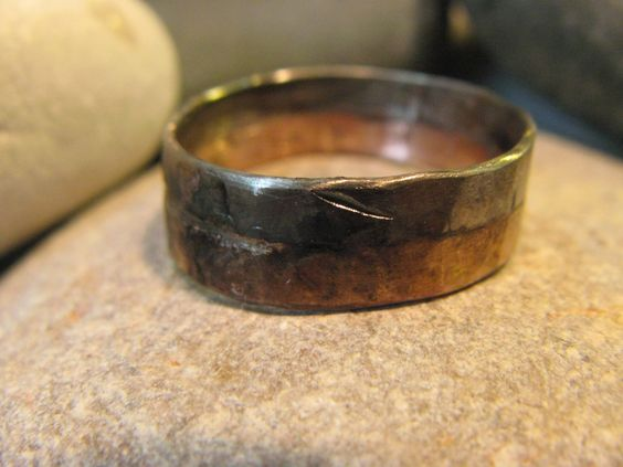 """Men's dark, rugged wedding ring made from 14k rose gold and palladium.Ring is about 1mm thick. Widths available are:4mm by 1mm6mm by 2mm8mm by 2mm10mm by 2mmI will oxidize your ring to make it darker. I'll also make it an uneven width, with solder """"dots"""" on the solder seam between the two metals.This general look is the Dark Rugged. I also have a regular Rugged and a Melted look. See my other ring listings.http://www.emilywiser.com/product/melted-we..."""