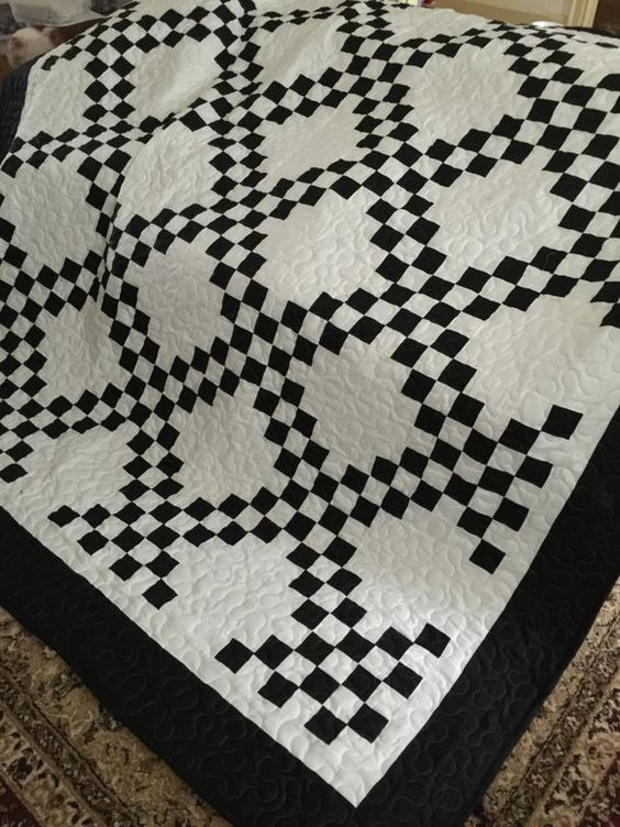 Quilt.Ready to Ship  This Black and White Irish Chain Queen size quilt is ready to ship. It is made from 100% cotton and measures 90x90  This listing the last larger border is black. I have another listing in my shop with a white border as the last larger border.  It would look