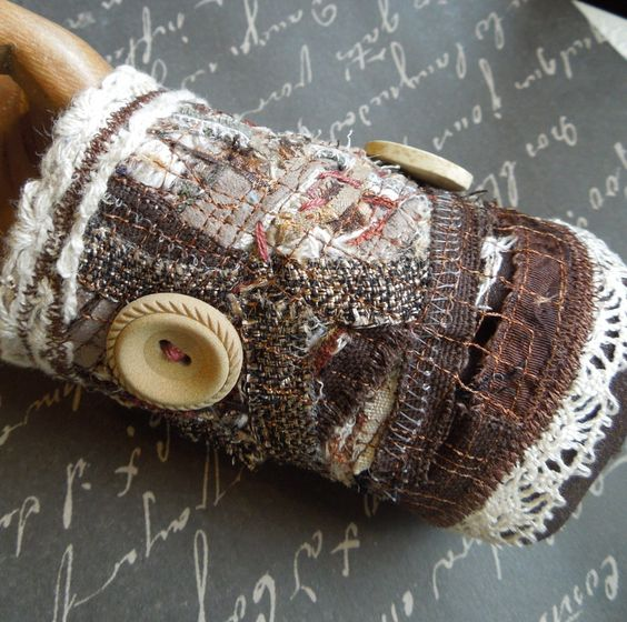 Brown, Collaged Bohemian Textile Fabric Wrist Cuff with 3 Buttons. $25.00, via Etsy.