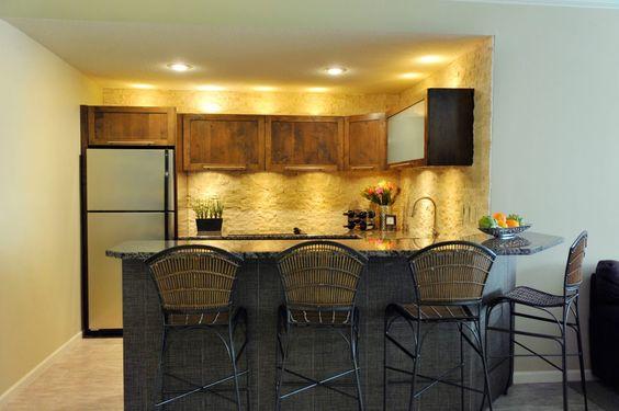 Suhr Interior Design/ Modern-Euro Kitchen: Alder wood, linen-tile bar surround, limestone backsplash.