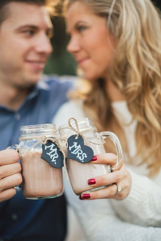 Ask your photographer to snap a shot of you two toasting with hot cocoa. It'll be a fabulous photo op to show off that ring! | Mr. and Mrs. Mason Jar Mugs | First Christmas as Mr. And Mrs. |  @JoPhotos