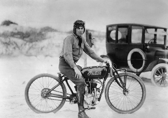 Circa 1920. Herbert McBride, who recently broke the world's motorcycle record for amateurs on his Indian.  His time was 105:24 miles per hour, which beats the old professional speed record.