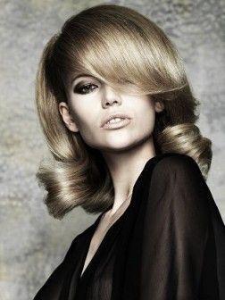 Retro hair.  Vintage big curls for medium length hair.