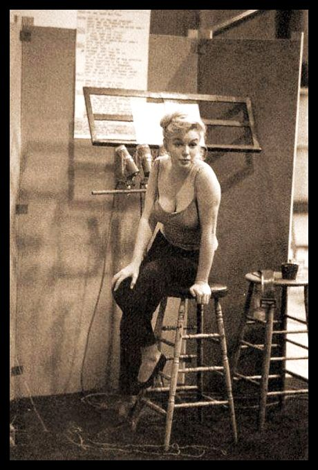 marilyn Monroe photographed during a recording session for Let's Make Love, 1960.