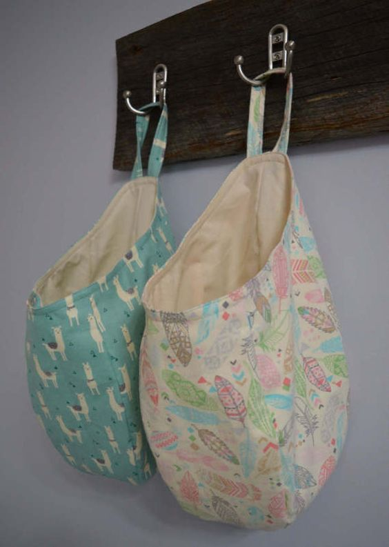 This is a pattern + tutorial for a hanging pod storage basket. These bags are great for stuffing full of grocery bags, tossing in loose toys to get them out of sight, filling with winter-wear like scarves, hats, and gloves, etc. This is a quick and easy project which should take