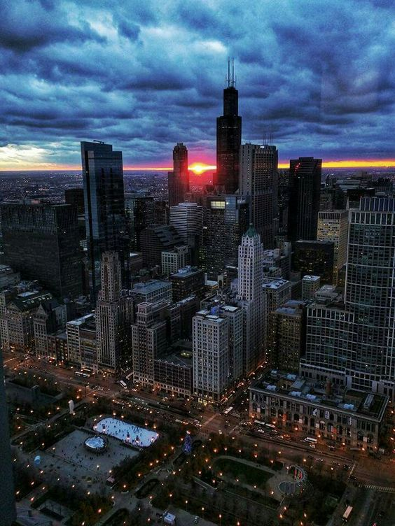 Partly cloudy sunset over the city. Sear Tower aka Willis Tower. Millennium Park. Cloud Gateway. The Bean. Silver Cloud. Ice skating rink. Michigan Ave. Coliseum.