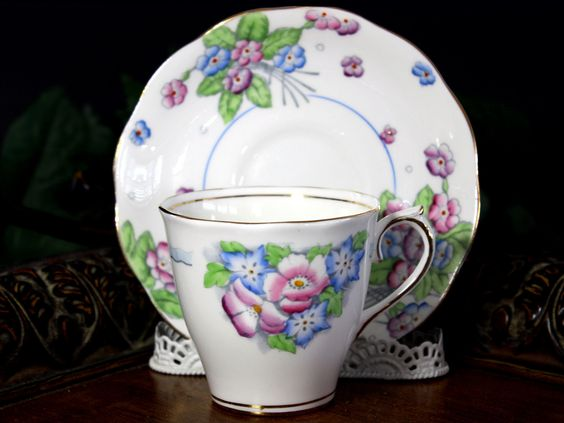 Royal Albert, Floral Teacup and Saucer, Vintage Tea Cups, Bone China A sweet, older set from the highly collectible Royal Albert Company. Pink and blue florals on a white background. Slight wear to th