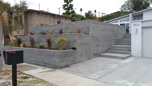 Retaining Walls Create A Level Surface In A Sloped Area They Can Also Enhance And Provide An Attract In 2020 Concrete Retaining Walls Concrete Planters Retaining Wall