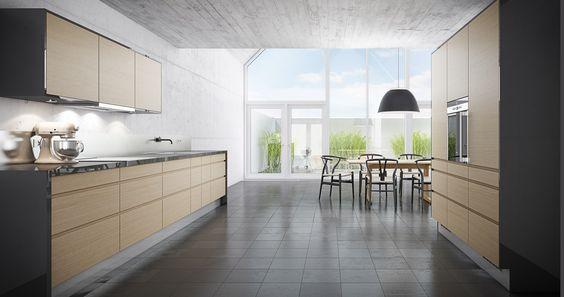 Stilrent køkken der står i kontrast til den markante rå væg ...