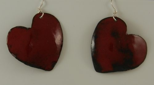 Medium sized lead-free red enamel heart earrings hung on Sterling silver ear wires.  2490