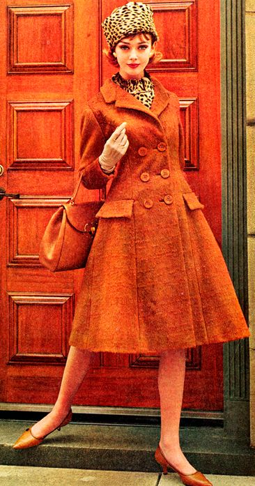 Merle Lynn is wearing a coat by Jacques Griffe, 1965- Love the tangerine with the animal print!