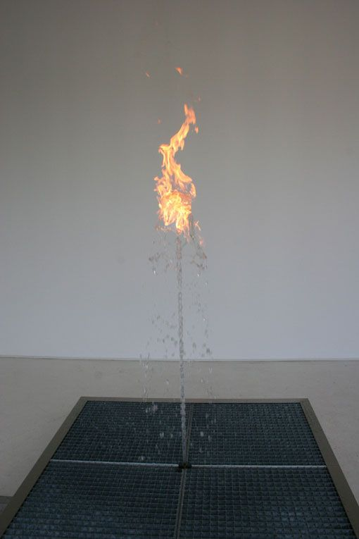 Water Flame is a mind-boggling installation by artist Jeppe Hein that features two opposing elements coexisting—water and fire. The installation, which is essentially a small fountain with a flame dancing atop the stream of cascading water, creates the paradoxical visual effect by dispelling a dose of natural gas through the water, making it flammable and able to emit a ball of fire at the center.