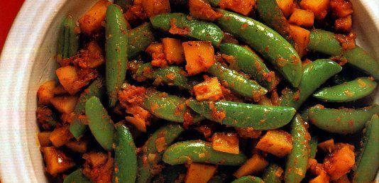 Vainas de guisantes al curry