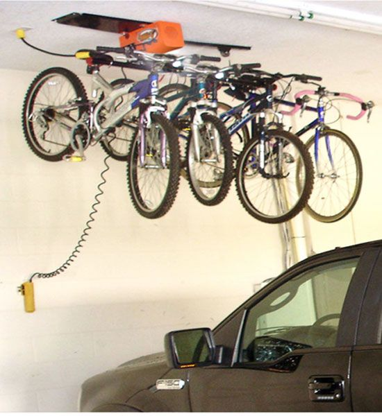 This 4 Hook Bike Storage System  allows you to easily store bikes on your garage ceiling for safekeeping.
