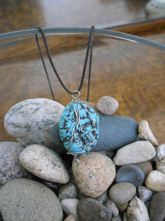 This is one of my favorite pendants that I wear a TON with my faux turquoise bracelets that are shown as well ...
