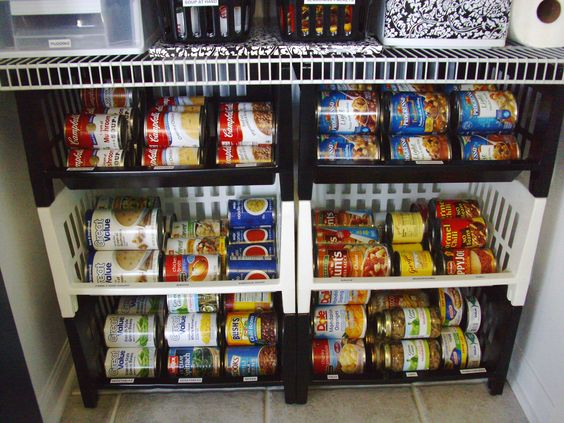 Pantry organization: I repurposed stacking bins that had been in the basement forever for organizing canned goods.: