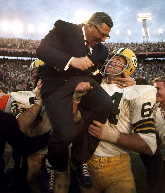 Vince Lombardi shares a moment with Jerry Kramer, who carried the coach off the field after their 33-14 Super Bowl II win against the Raiders. The game marked Lombardi's last as a Packers head coach.