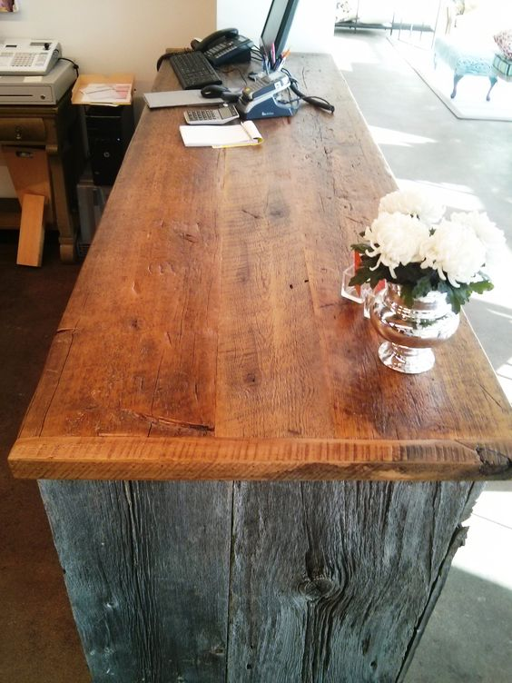 Reclaimed barn board cash desk we created for a client using grey barn board and 2 inch thick hemlock floor boards