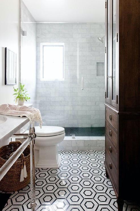 Black And White Hexagon Floor Tiles Complement A Small Elegant Bathroo Bathroom Tile Designs Hexagon Tile Bathroom Floor Black And White Hexagon Tile Bathroom Black and white bathroom floor