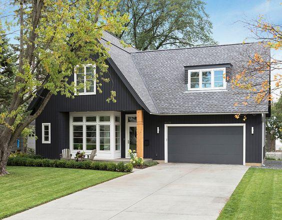 exterior paint color: Black Jack 2133-20; garage door and dark trim: French Beret 1610; white trim: Decorator White. All by Benjamin Moore. Charlie & Co. Design, Ltd.:
