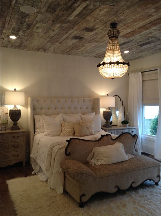 A lovely mix of delicate softness and rustic elements, all working together to make a beautiful bedroom.