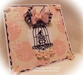 Cheryl Walker:  Sweeet Designs by Cheryl. CottageCutz dies: Beautiful Bella Spring Corners, Ornate Birdcage, Oval Doily and Frame. Creative Inspiration Paints: Black Embossing powder on bird cage..