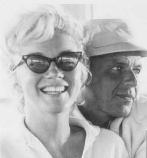 Marilyn with Frank Sinatra. Love how happy and carefree she looks in this photograph taken in 1961.