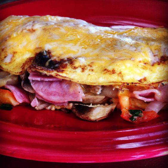 Three Egg Omelette with Cheddar Jack cheese, Ham, Bellpeppers, Onions and Mushrooms