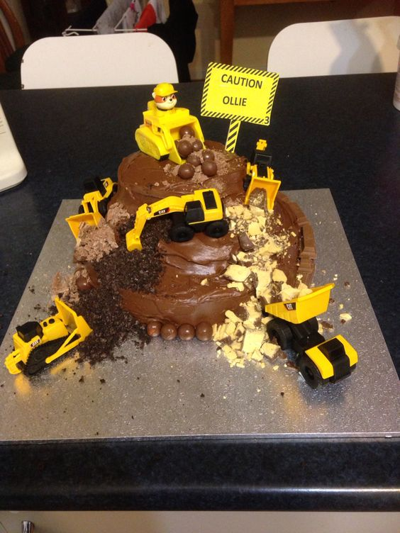 Construction Birthday cake with Rubble from paw patrol on top.