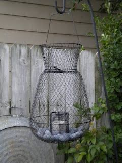 This old fish basket made a perfect outdoor hanging candle holder and it's a great outdoorsie look for the cabin.