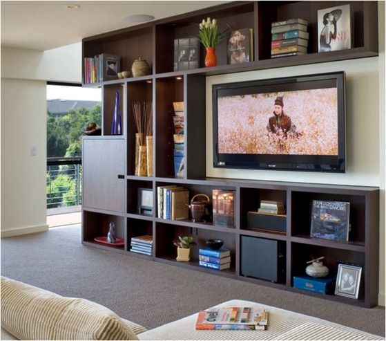 built-in bookcase frames big-screen tv... and other ideas to design around  a tv... general rule of thumb is that the distance from the television s… - Built-in Bookcase Frames Big-screen Tv... And Other Ideas To