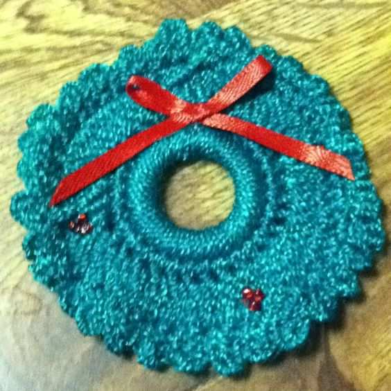 Crocheted Christmas wreath lapel pin