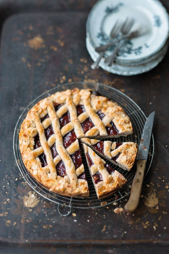 Linzer Torte: Austrian tart with a dough flavoured with lemon zest, hazelnut and cinammon, topped with redcurrany jam and  decorated with a pastry lattice.